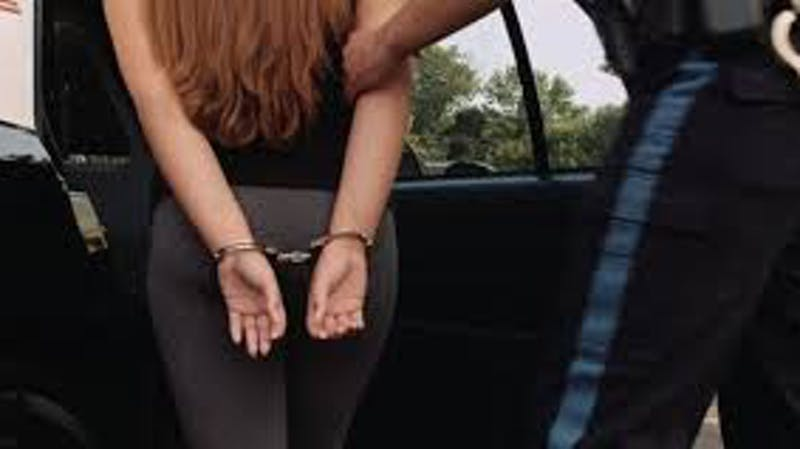 A young girl arrested and handcuffed