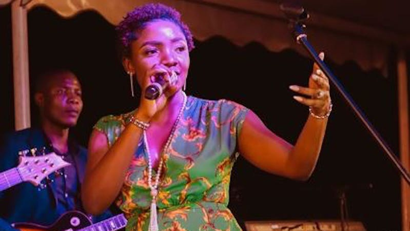 Simisola performing on a stage