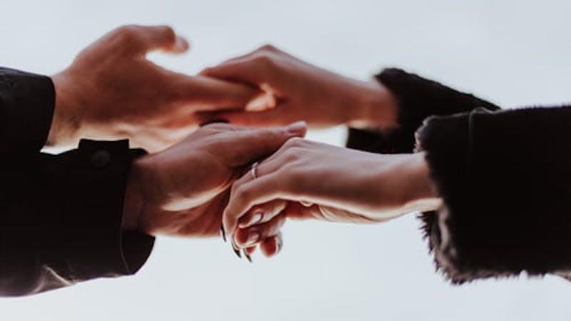 Friends extending hands of friendship