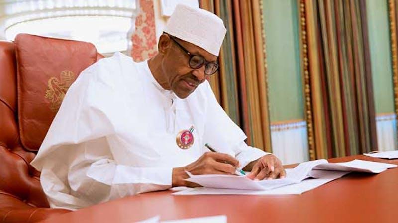 President Muhammadu Buhari signing documents