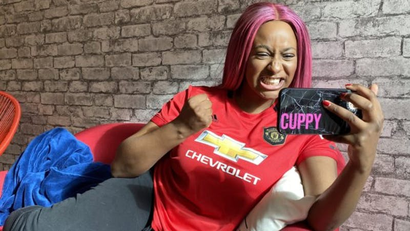 DJ Cuppy in her official Man U jersey