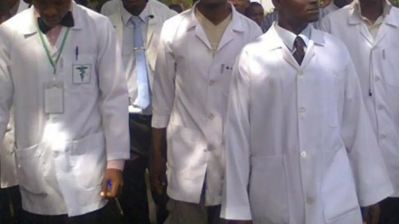 Health workers on their lab coat and medical equipments
