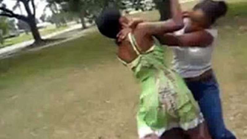 Two black women fighting over a man