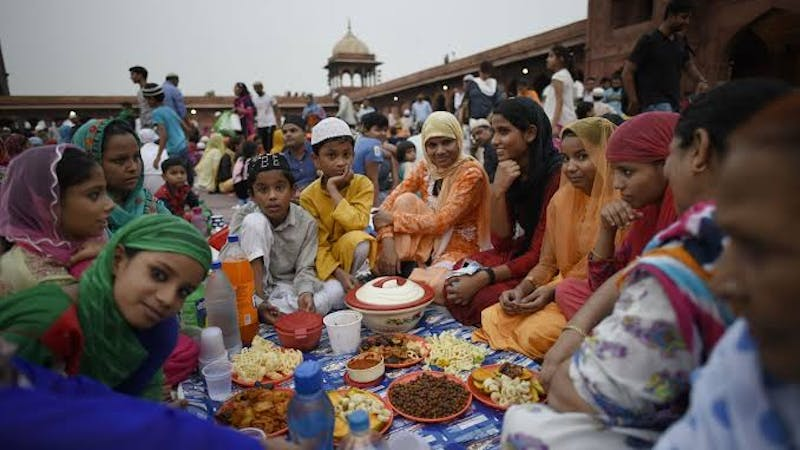 Holy Ramadan: A muslim family eating healthy meal during the Iftar