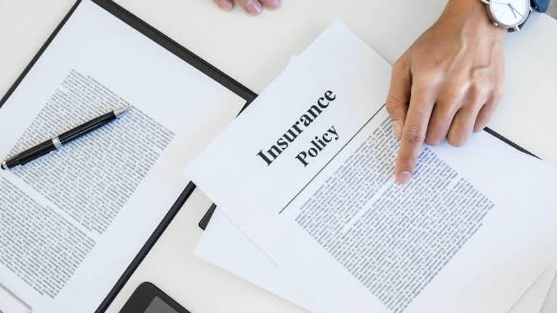 Business: An entrepreneur signing a business insurance contract