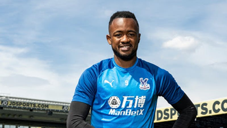 Crystal Palace striker Jordan Ayew poses with his player of the season's award.