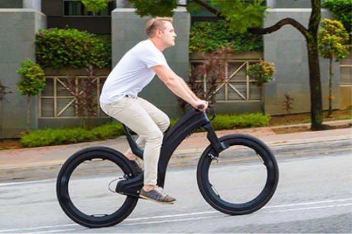 Man on futuristic looking bicycle