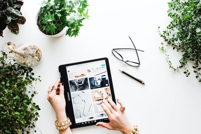 Woman using an iPad to do online shopping