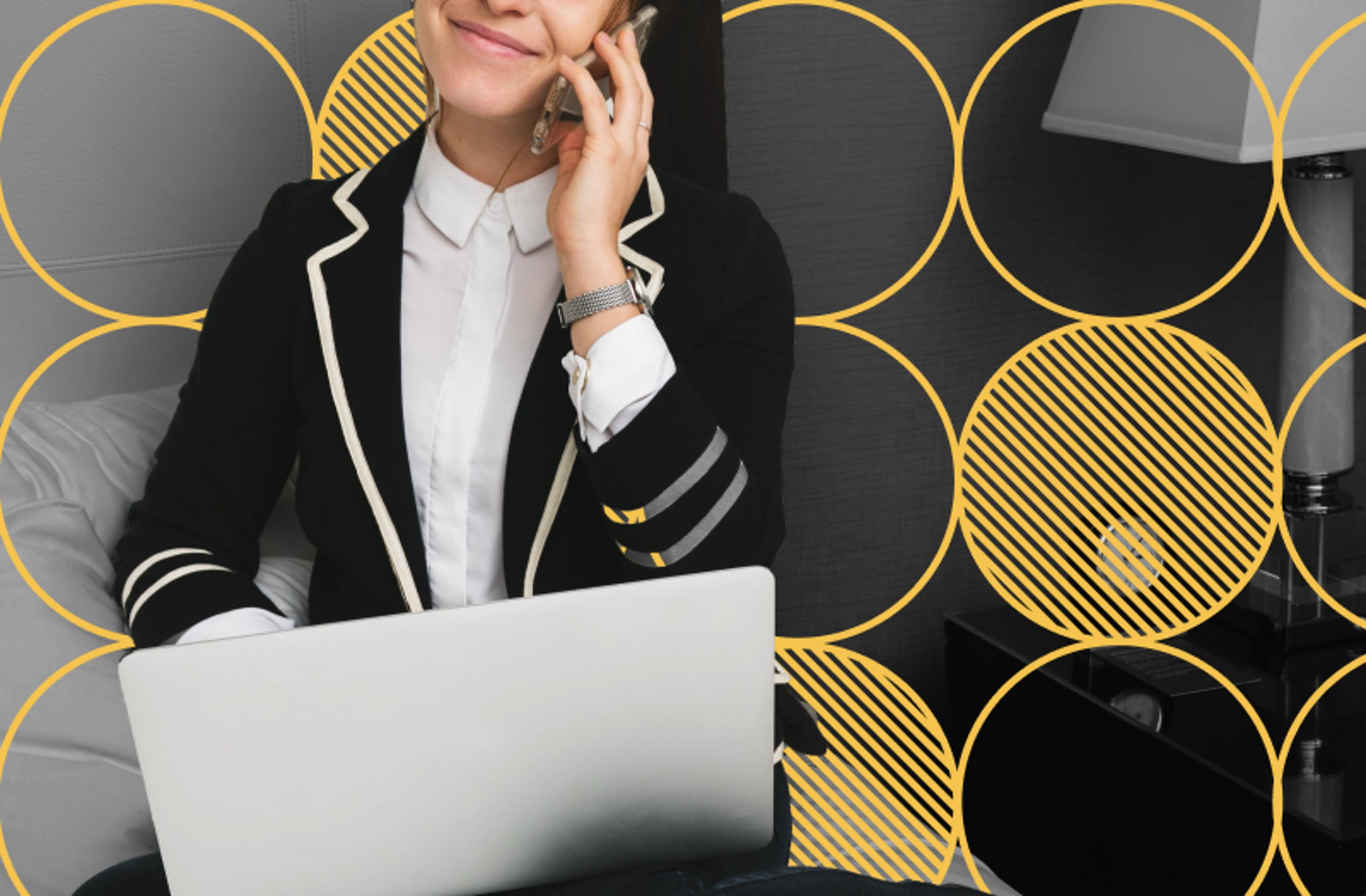 lady smiling with phone and laptop