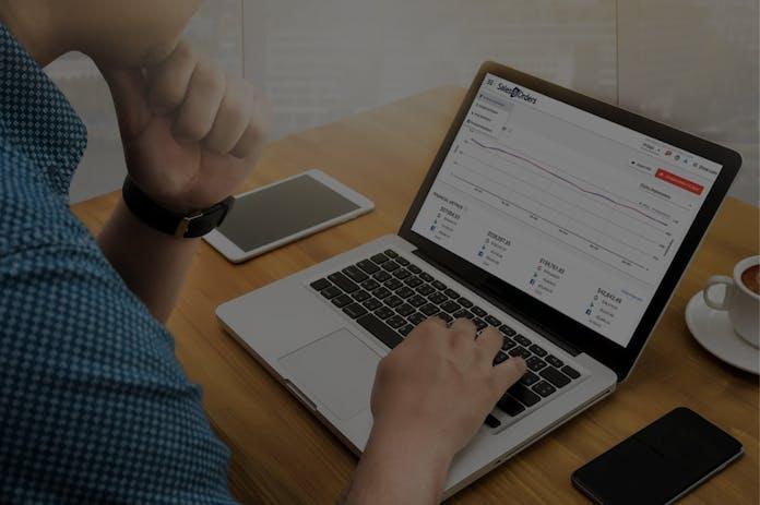 Man using laptop to look at statistics