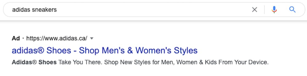 """A google search for """"Adidas sneakers"""" with an ad for Adidas shown below"""