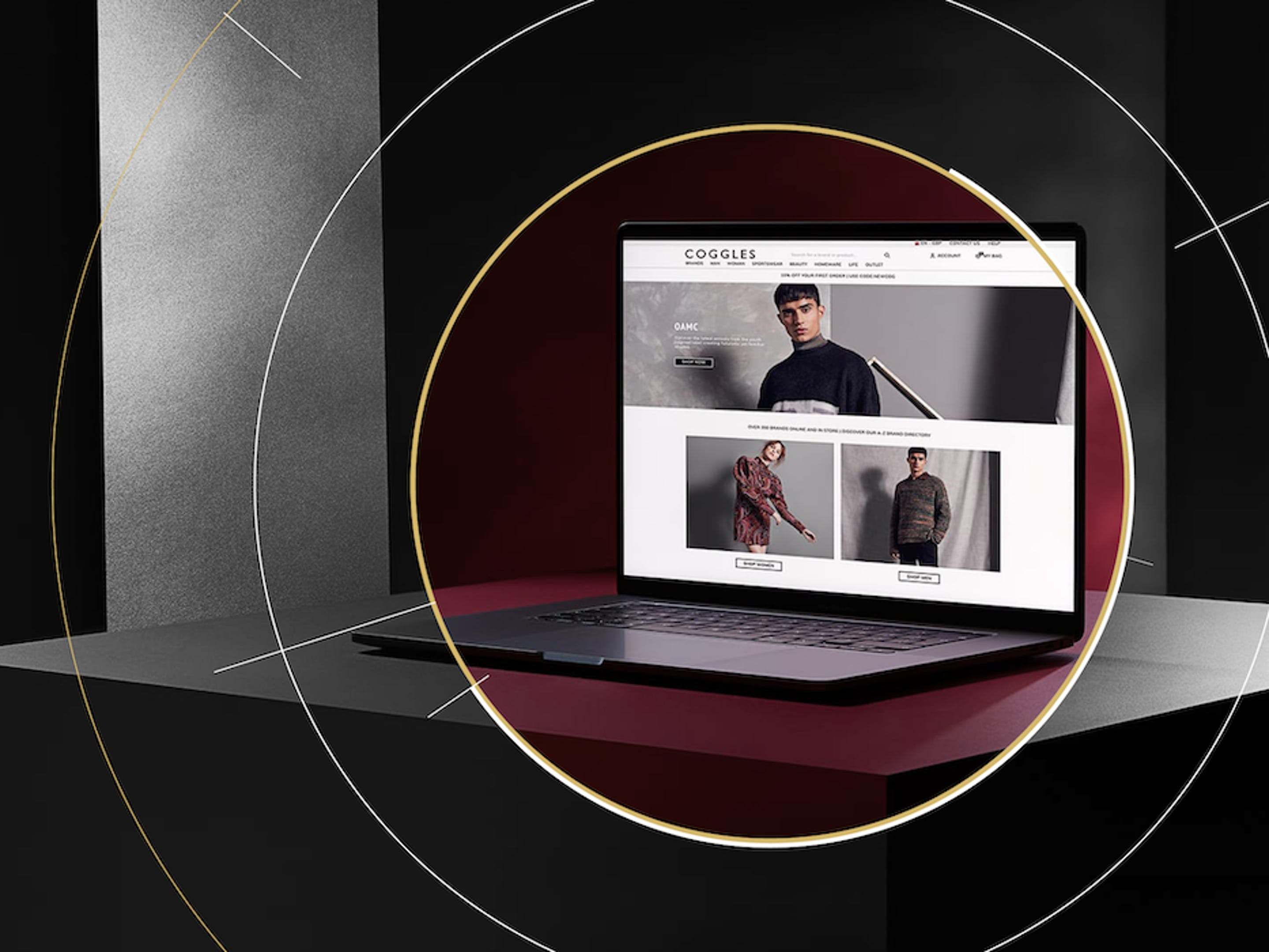A laptop sits open on a desk. The screen shows the homepage of the Coggles website, an e-commerce fashion retailer.