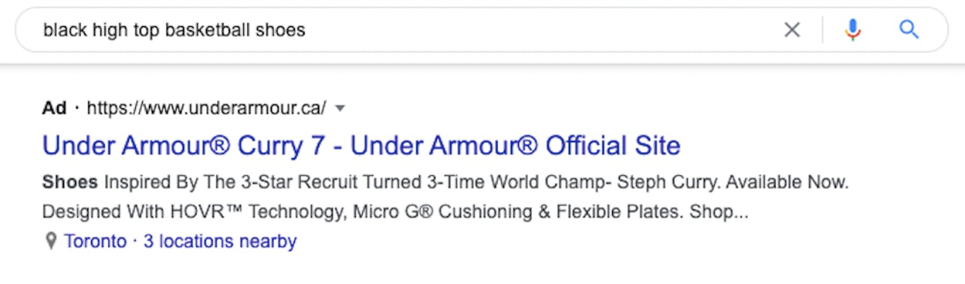"""A google search for """"black high top basketball shoes"""" shows an Under Armour ad as the top result"""