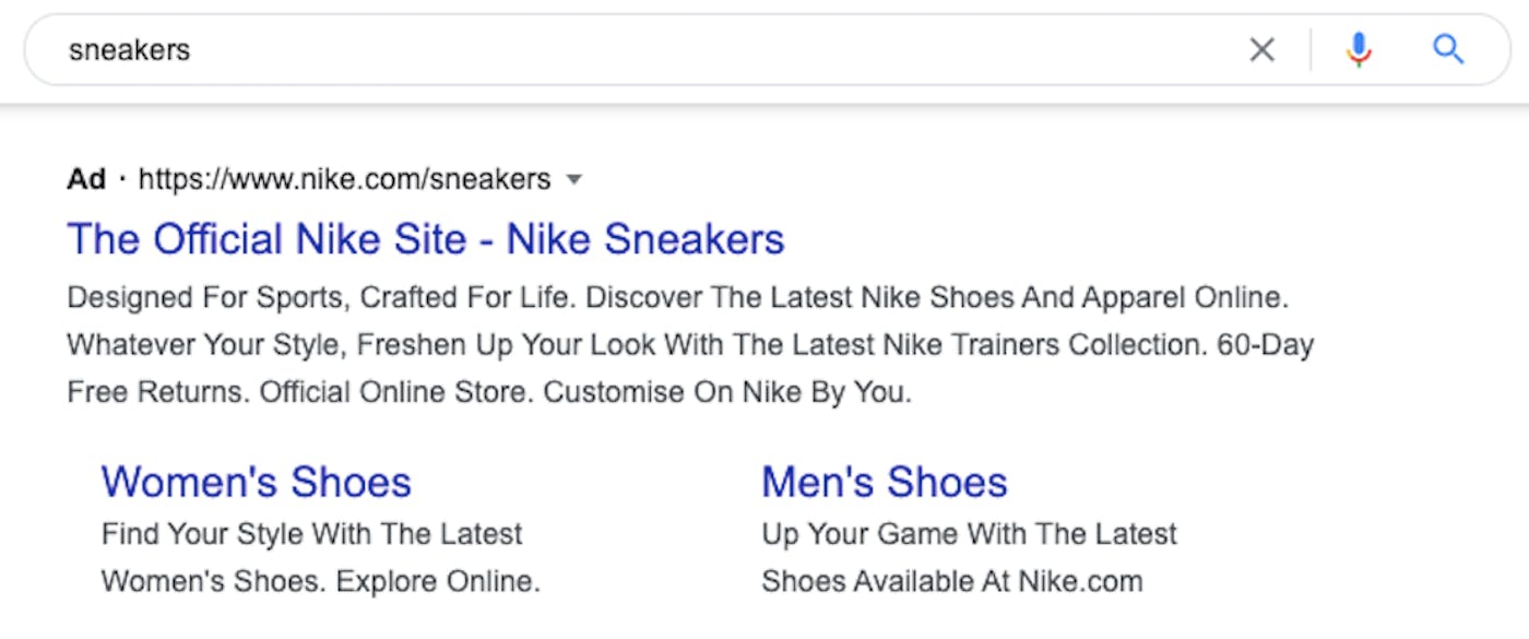 """A google search for """"sneakers"""" shows a Nike ad as the top result"""