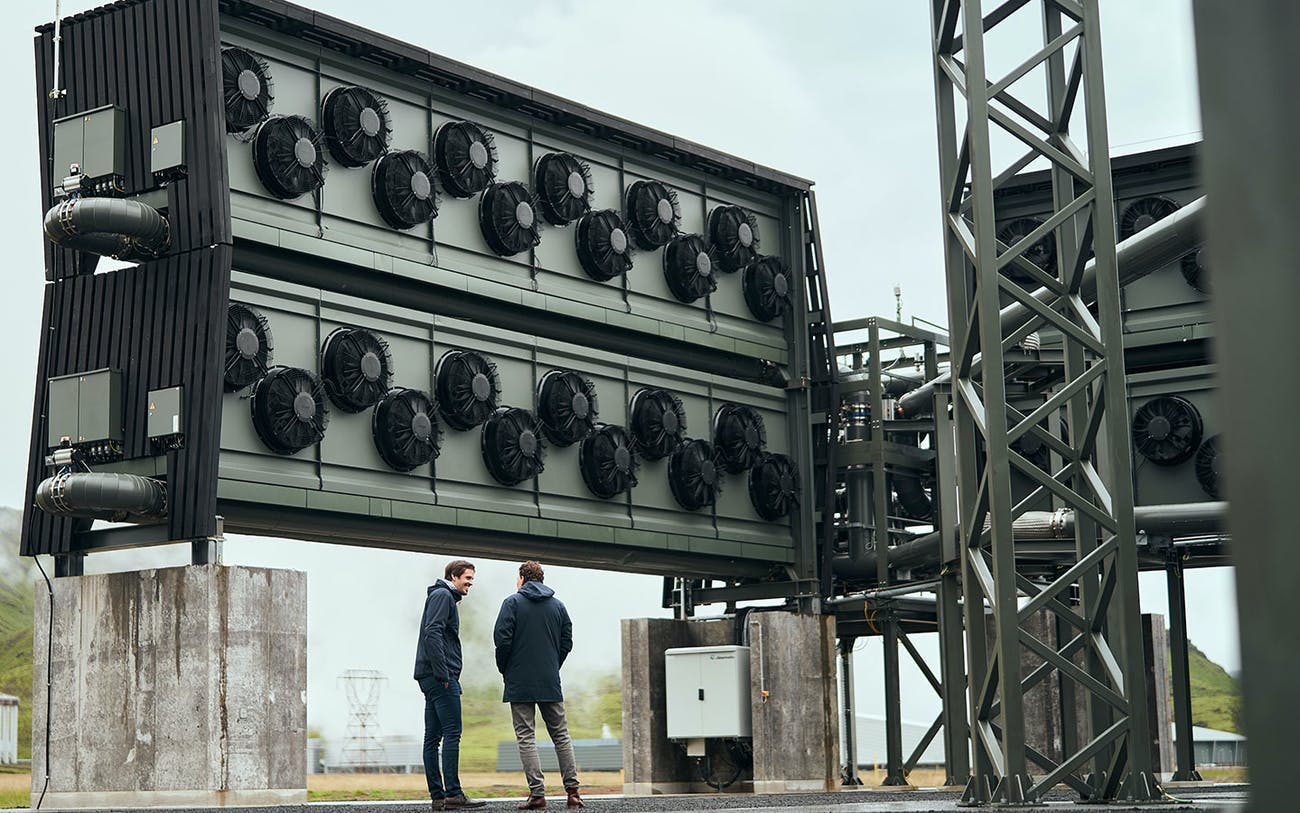 Co-CEOs Jan Wurzbacher and Christoph Gebald stand in front of the direct air capture plant Orca