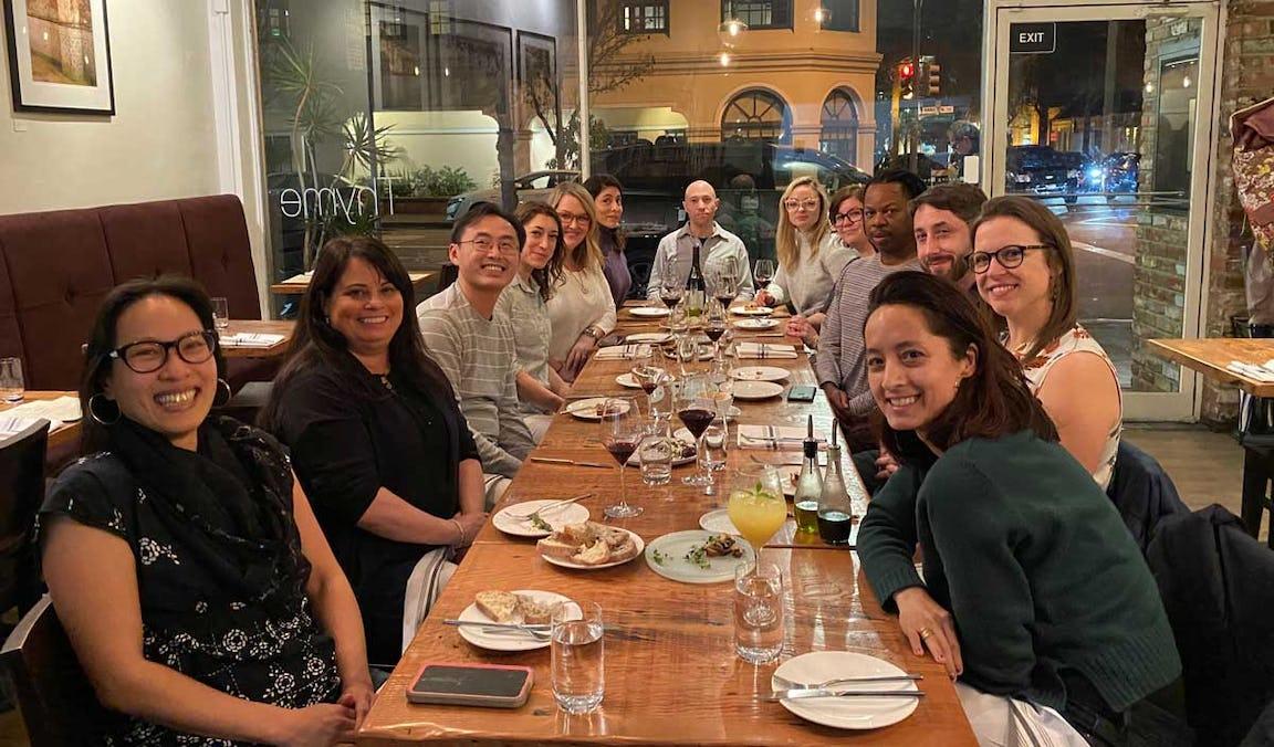 Members of the Smith team celebrating over dinner