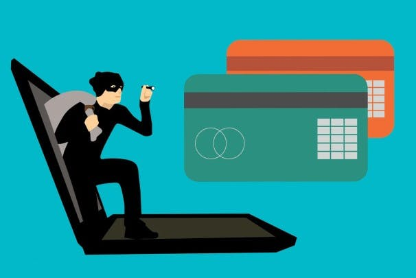 an image depicting skimming of bankcards as a cyber threat