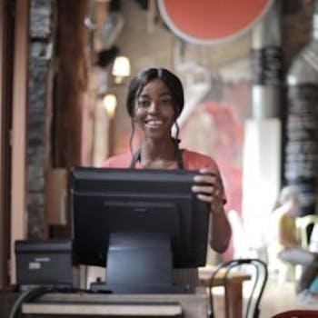 Cea3bad6 35e5 432b ab4b 44b969abfff3 cheerful black waitress standing at counter 3801426 360x256