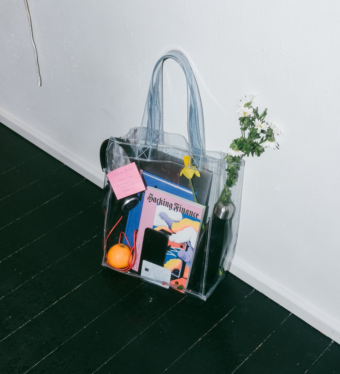 A clear bag containing an assortment of items