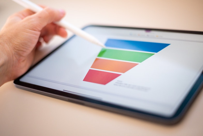 person using tablet to show funnel of a process