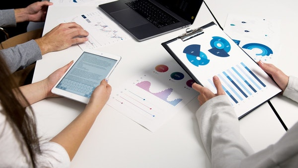 workers looking at business data, business traction