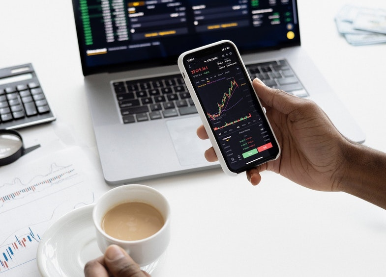 Investor checking stocks on devices, investment research