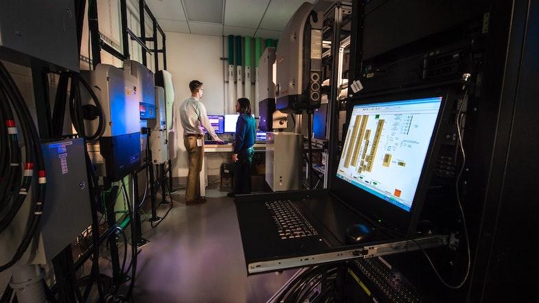 Data scientists in computer lab, data normalization