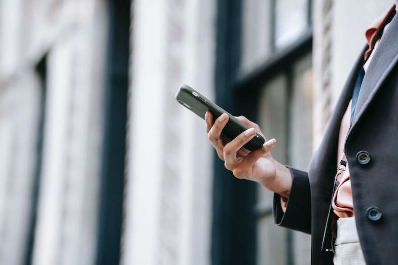 Business professional using cell phone