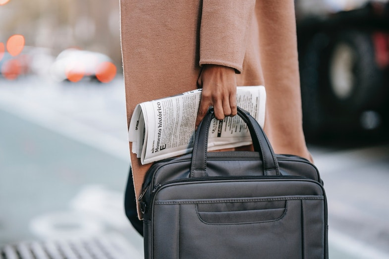 Business man with newspaper, hedge fund industry trends