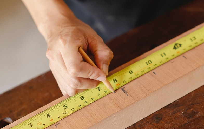 Person measuring with measuring tape
