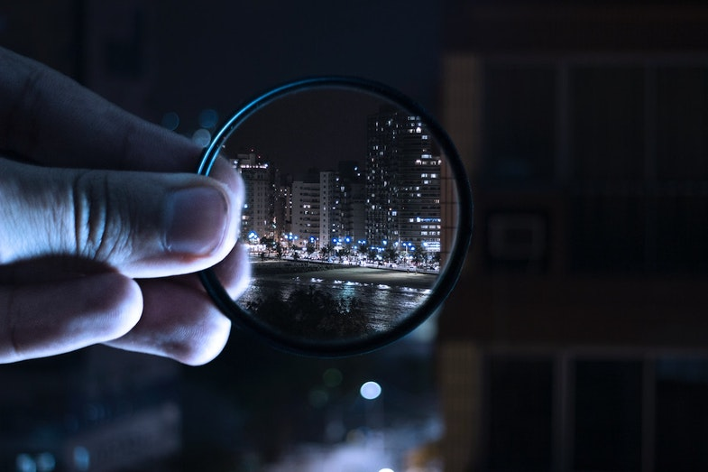 magnifying glass with skyscrapers