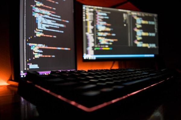Computer screen displaying data and programming
