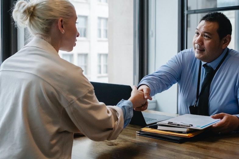 Employer hiring a new employee, shaking hands