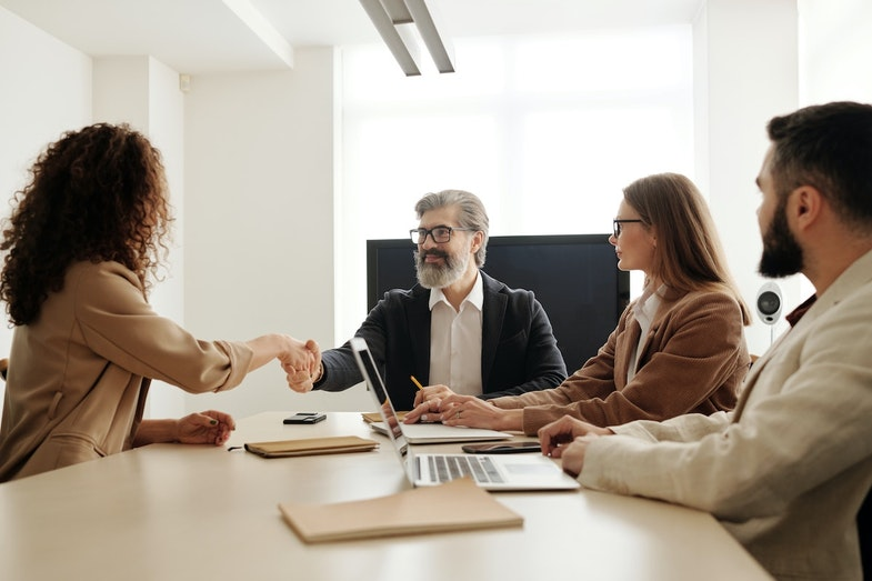 Business professionals hiring a job candidate with handshake