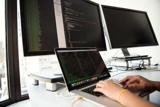 Developer coding on computers