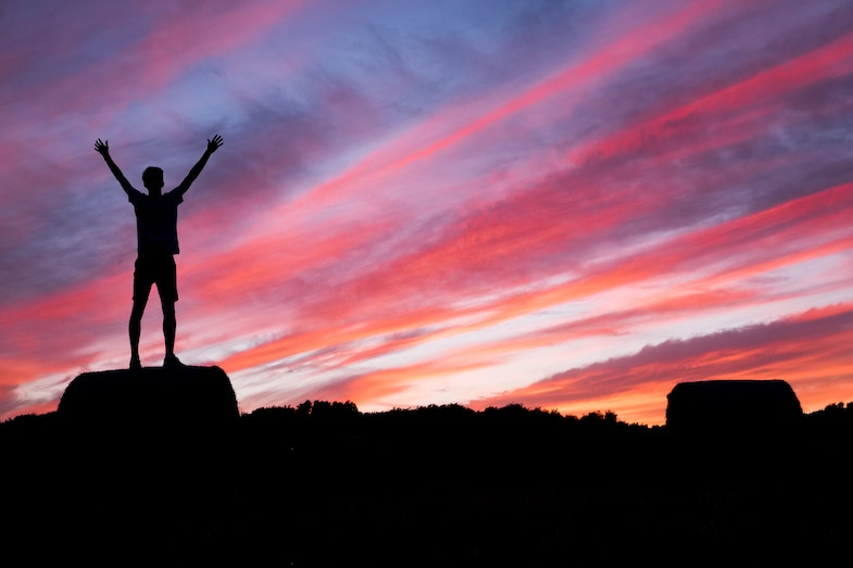 Person standing successfully on mountain