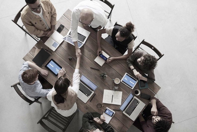 workplace meeting at conference table