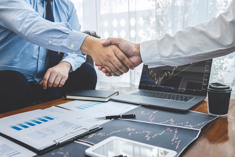 Business handshake for M&A transaction