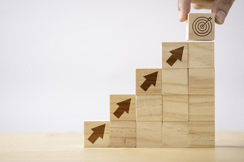 building blocks pointing up towards target goal