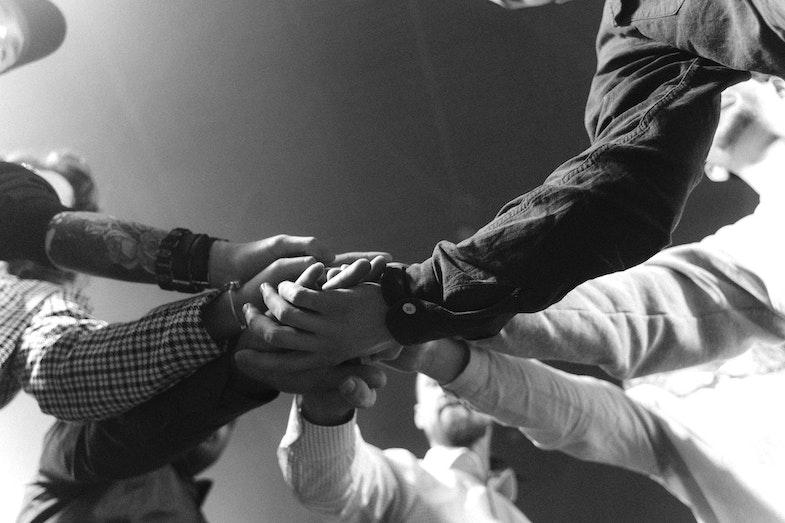 hands celebrating teamwork, workforce analytics