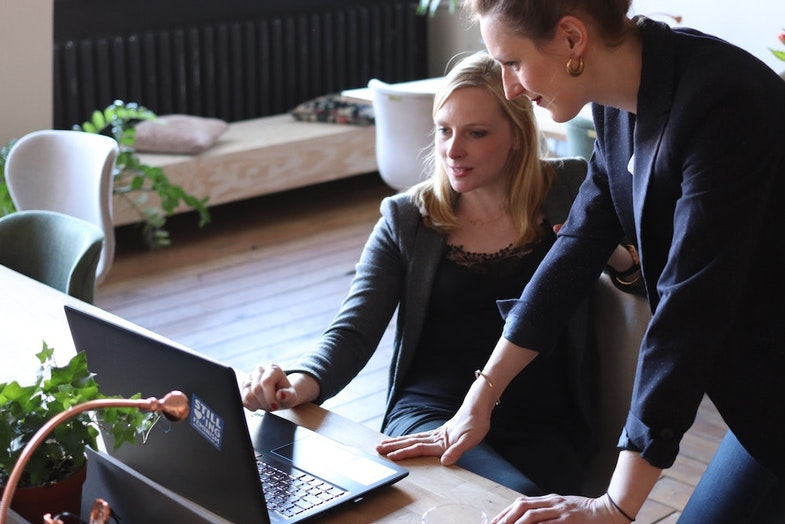 Two business people looking at laptop