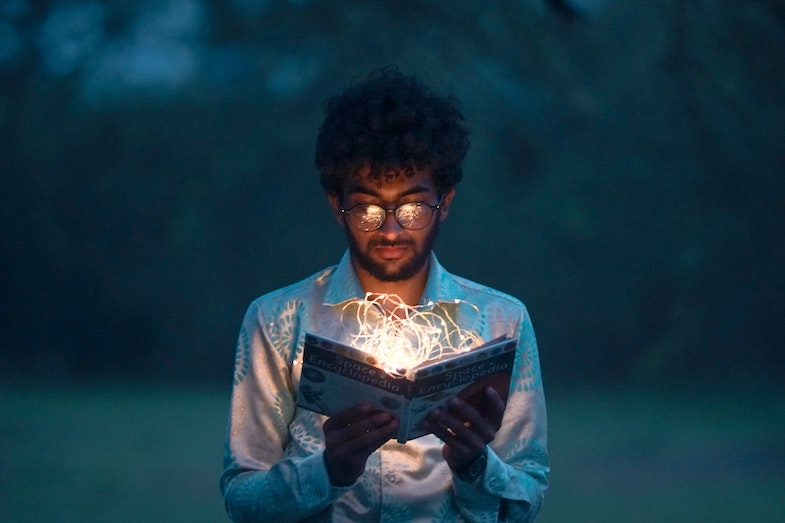 person holding book with lights