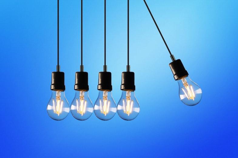 lightbulbs swinging transformation technology