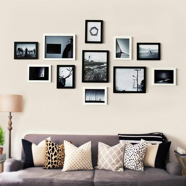 black and white frames decorated above the sofa, on the wall