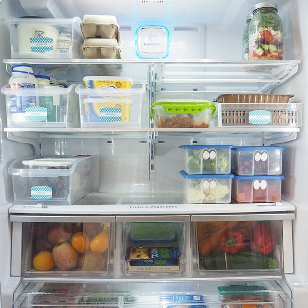 very organised fridge with boxes and jars