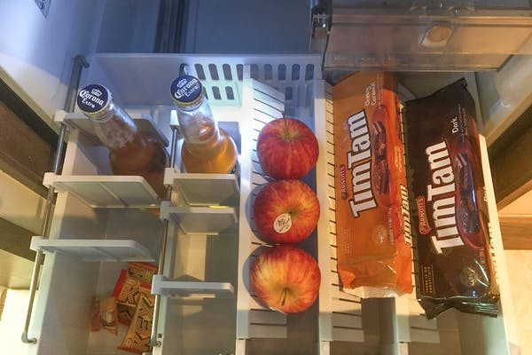 beers, chocolate snacks and fruits in the fridge