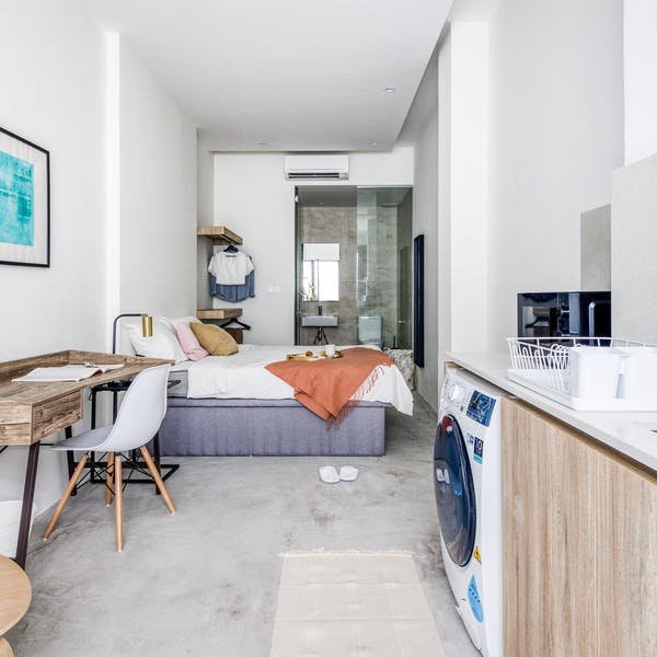 a studio room where kitchen and toilet are all in