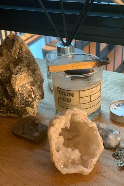 crystals and candle on the table