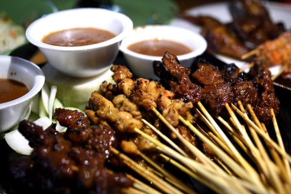 satay, a Malay styled skewered BBQ meat served with peanut sauce