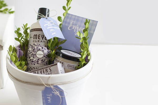 soap, cleaning essentials in a basket